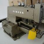 Ραπτομηχανή Singer κουμπί
